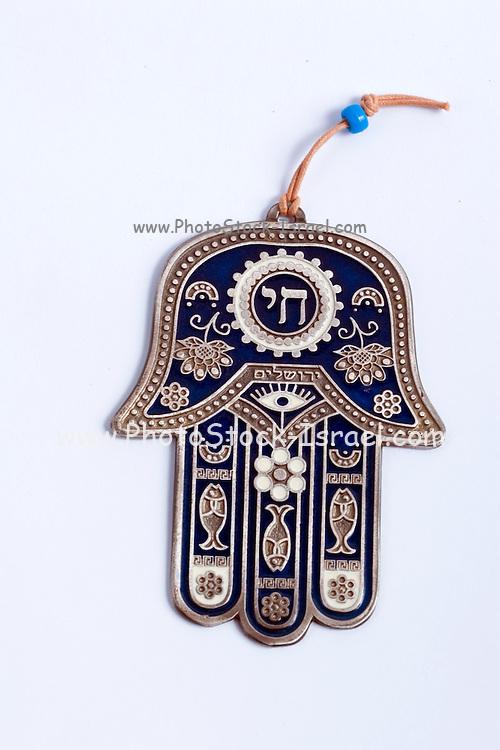 Studio shot of a decorated silver Hamsa amulet