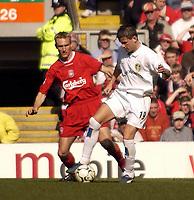 Photo. Jed Wee, Digitalsport<br />Liverpool v Leeds United, FA Barclaycard Premiership, Anfield, Liverpool. 23/03/2003.<br />Leeds' Eirik Bakke (R) holds off Liverpool's Sami Hyypia.