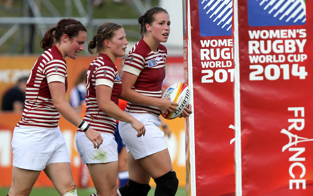 Becky Essex, Lydia Thompson and Emily Scarratt after Emily scored a try. England v Samoa Pool A group game, WRWC 2014 at Centre National de Rugby, Marcoussis, France, on 1st August 2014