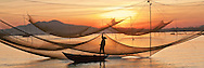 catching fish in the HoiAn river.HoiAn is the ancient town in the middle of VietNam.