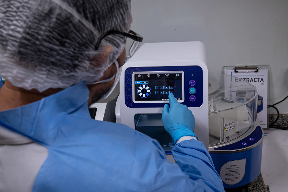 Lab technicians use a PerkinElmer Janus Automated Workstation to extract RNA and DNA for Covid testing at Lacen Central Laboratory March 30, 2021 in Manaus, Brazil. Brazilian residences are receiving the CoronaVac vaccine, also known as the Sinovac COVID-19 vaccine. CoronaVac is an inactivated virus COVID-19 vaccine developed by the Chinese company Sinovac Biotech and has been in Brazil's Phase III clinical trials. Photo Ken Cedeno