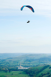 A paraglider flies from the hills around Mam Tor with Hope Cement Works  in the background <br />  11 October 2015<br />   Image © Paul David Drabble <br />   www.pauldaviddrabble.co.uk