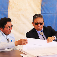 Council Delegate Jimmy Yellowhair and Vice President Myron Lizer look over the blueprints for a judicial/public safety facility in Piñon, Arizona.