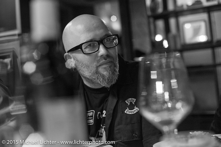 BMW head of design and dinner host Ola Stenegard at Deus in Milan during EICMA, the largest international motorcycle exhibition in the world. Milan, Italy. November 17, 2015.  Photography ©2015 Michael Lichter.