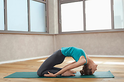 Woman in fitness studio spine back exercise
