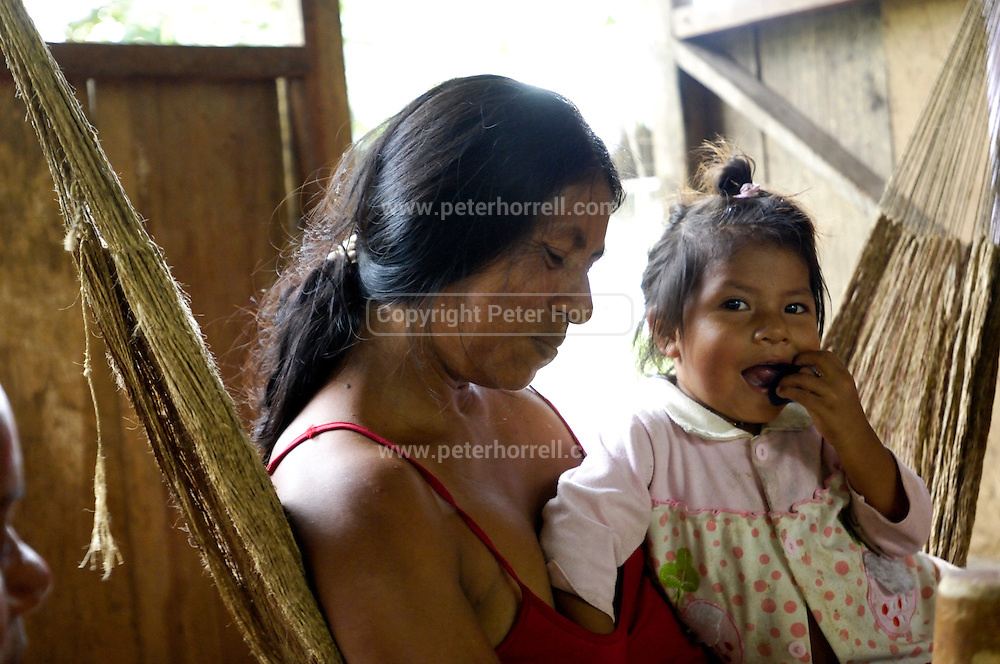 Ecuador, May 6 2010: Moi's wife and daughter.Copyright 2010 Peter Horrell