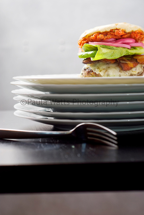 Bacon cheeseburger on plates in modern setting