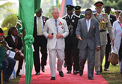 The Prince of Wales (centre) attends a service of commemoration at the Abuja Memorial, Nigerian National Military Cemetery, in Abuja Nigeria, on the final day of his trip to west Africa with the Duchess of Cornwall.