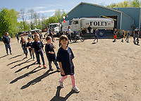 "Elm Street School Kindergarteners arrive at Foley Oil ""ready to go to work"" during their field trip on Wednesday morning.  (Karen Bobotas/for the Laconia Daily Sun)"