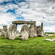 Stonehenge Panorama of Southwest Face. Believed to have been built somewhere between 2000 and 3000 BC, Stonehenge is one of the United Kingdom's most distinctive landmarks. It's function and purpose remains a matter of conjecture, although many theories have been offered. It consists of a series of large standing stones, some of which have toppled over the centuries. Stonehenge is located in Salisbury Plain west of London.