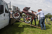 Travellers from across the West Country and beyond try out Romany carriages and horses at the ancient annual Priddy Sheep (and horse) fair in Somerset, England. Offloading the carriage, the men will parade around a field on the outskirts of the village, hoping to sell the vehicle. Set in the Mendip Hills, in the south-western English county of Somerset, the Priddy Sheep fair is host to an odd mix of farmers and travellers (commonly and incorrectly known as gypsies). In this field set aside purely for travellers, many with West Country accents but also with nearby Welsh and Irish too, deals are done with a traditional spit on the hand and a smacking of palms, selling a pony to another family. The Priddy Sheep Fair moved from the city of Wells in 1348 because of the Black Death.