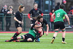 Wales women's Natalia John is tackled by Ireland women's Elaine Anthony<br /> <br /> Photographer Craig Thomas/Replay Images<br /> <br /> International Friendly - Wales women v Ireland women - Sunday 21th January 2018 - CCB Centre for Sporting Excellence - Ystrad Mynach<br /> <br /> World Copyright © Replay Images . All rights reserved. info@replayimages.co.uk - http://replayimages.co.uk
