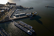 Nederland, Zuid-Holland, Rotterdam, 18-02-2015. Botlek, Geulhaven met Verkeerscentrale Rotterdam. Binnenvaarttankers liggen voor anker, in de achtergrond  LBC tank terminals.<br /> Main harbor traffic station, moored inland tankers and oil terminals.<br /> luchtfoto (toeslag op standard tarieven);<br /> aerial photo (additional fee required);<br /> copyright foto/photo Siebe Swart