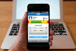 Using iPhone smartphone to display NHS (National Health Service) BMI (Body Mass Index) calculator
