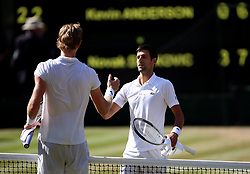 Novak Djokovic (right) and Kevin Anderson after the Gentlemen's singles final on day thirteen of the Wimbledon Championships at the All England Lawn Tennis and Croquet Club, Wimbledon.