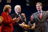 12 JAN 2003, BRAUNSCHWEIG/GERMANY:<br /> Angela Merkel (L), CDU Bundesvorsitzende, Edmund Stoiber (M), CSU, Ministerpraesident Bayern, und Christian Wulff (R), CDU Landesvorsitzender Niedersachsen, mit Handpuppen des Braunschweiger Loewen, Wahlkampfauftakt der CDU Niedersachsen zur Landtagswahl, Volkswagenhalle<br /> IMAGE: 20030112-01-061<br /> KEYWORDS: Spitzenkandidat, Ministerpräsident,