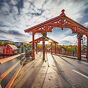 website:www.azinasutiphotography.com <br /> This picture has been taken in a beautiful October Day in Trondheim over the old bridge town which is called Lykkens Portal (Gate of happiness) or Gamle By bro.