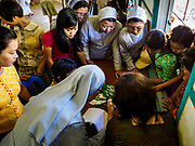 19 NOVEMBER 2017 - HWAMBI, YANGON REGION, MYANMAR: People line up at Sacred Heart's Catholic Church in Hwambi to get tickets to attend the Papal Mass in Yangon. The public mass will be held November 29. Catholics in Myanmar are preparing for the visit of Pope Francis. He is coming to the Buddhist majority country November 27-30. There about 500,000 Catholics in Myanmar, about 1% of the population. Catholicism was originally brought to what is now Myanmar more than 500 years ago by Portuguese missionaries and traders.    PHOTO BY JACK KURTZ