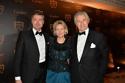 Left to right, LAURENT FENIOU, CARLA BAMBERGER and ARNAUD BAMBERGER at the 26th Cartier Racing Awards held at The Dorchester, Park Lane, London on 8th November 2016.