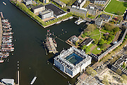 Nederland, Noord-Holland, Amsterdam, 09-04-2014;<br /> Detail Marineterrein (boven), beneden Scheepvaartmuseum, links  kade van Nemo met historische woonboten. <br /> Close up navy area (right) and the National Maritime Museum (white building)<br /> luchtfoto (toeslag op standard tarieven);<br /> aerial photo (additional fee required);<br /> copyright foto/photo Siebe Swart