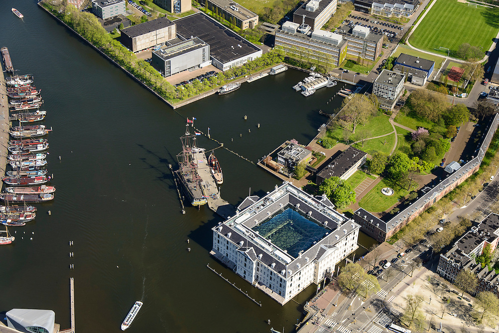 Nederland, Noord-Holland, Amsterdam, 09-04-2014;<br /> Detail Marineterrein (boven), beneden Scheepvaartmuseum, links  kade van Nemo met historische woonboten. <br /> Close up navy area (right) and the National Maritime Museum (white building)<br /> luchtfoto (toeslag op standard tarieven);<br /> aerial photo (additional fee required);<br /> copyright foto/photo Siebe Swart