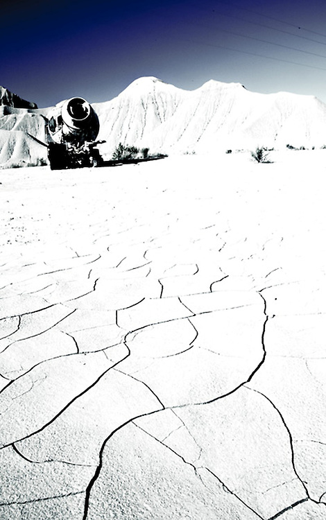 Abandoned Cement Truck in Cracked, Desert Landscape