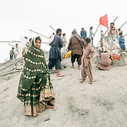 """The steep trek to the rim of the highest volcano is the first ritual of the Hinglaj pilgrimage. Pilgrims come up to throw a coconut in the cold mud (to thank the gods for granting their wish) and to apply the holy mud to their faces etc. The area around Chandragup (meaning """"Moon Well""""), a sacred site to Hindu of 3 mud volcanoes (mainland Asia's largest ones)."""