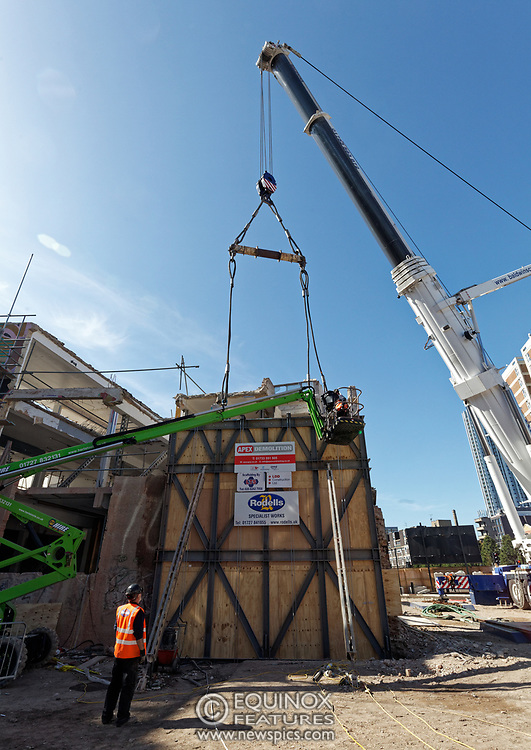 London, United Kingdom - 20 September 2019<br /> EXCLUSIVE SET - Aerial construction specialists and demolition experts use a huge crane to carefully lift intact, a twenty five ton, two-story wall, to preserve a famous Banksy rat image which has been covered up for years. Teams from specialist companies have spent over six weeks cutting around the artwork and fitting custom made eight ton steel supports to enable them to save the historic piece of art. Work has started on the construction of a new twenty seven floor art'otel hotel on the site of the old Foundry building in Shoreditch, east London, and a condition of the planning permission was to preserve the historical Banksy graffiti. A second section of the painting, an image of a TV being thrown through a broken window has already been cut out and moved separately. After the hotel construction is complete the two parts of the Banksy painting will be displayed on the hotel. Our pictures show the stages of work to protect the image, culminating in the lifting of the three story wall by crane. Video footage also available.<br /> (photo by: EQUINOXFEATURES.COM)<br /> Picture Data:<br /> Photographer: Equinox Features<br /> Copyright: ©2019 Equinox Licensing Ltd. +443700 780000<br /> Contact: Equinox Features<br /> Date Taken: 20190920<br /> Time Taken: 13014163<br /> www.newspics.com