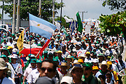 10 SEPTEMBER 2003 - CANCUN, QUINTANA ROO, MEXICO: Anti-globalization protestors march through downtown Cancun, Quintana Roo, Mexico during a protest against the WTO Wednesday. A Korean protestor killed himself during the protest when he stabbed himself in the chest and then fell or jumped from a nearby rooftop after shouting an anti-globalization slogan. Tens of thousands of people opposed to the WTO have come to this Mexican resort city to protest the 5th Ministerial meeting of the World Trade Organization. The WTO meetings are taking place in the hotel zone of Cancun, about 10 miles from the protestors.  PHOTO BY JACK KURTZ