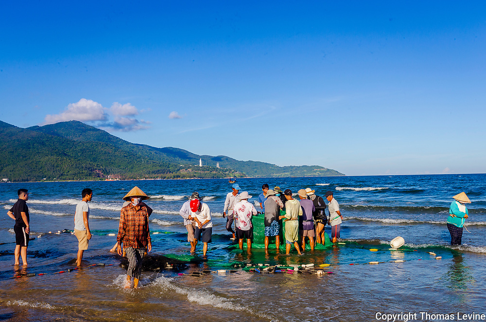 Oct. 2020, Da Nang: Local Vietnames bringing in their fishing net for the day's catch.