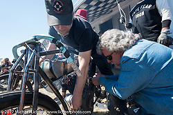 Paul Cox on his 1917 Indian Powerplus getting help from Berry Wardlaw before the start of Billy Lane's Son's of Speed race during Daytona Bike Week. New Smyrna Beach, FL. USA. Saturday March 18, 2017. Photography ©2017 Michael Lichter.