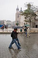 Market Square during a rain shower in Krakow Poland