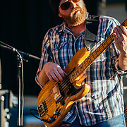 Jason Spooner performs to a packed crowd in Jackson, Wyoming. Portrait of bassist Adam Frederick.
