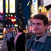 Excited tourist with eyes wide open on Times Square in New York City, USA