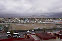 """(Image five of nine) Panorama of the Ensenada harbor in Mexico on a grey and raining day from the deck of the MV World Odyssey. The other cruse ship is the Carnival Imagination. Once all of the students, faculty, staff, and life long learners were aboard we would be ready to begin the 102 day """"round the world"""" Semester at Sea Spring 2016 Voyage. Composite of nine images taken with a Leica T camera and 23 mm f/2 lens (ISO 250, 23 mm, f/2, 1/80 sec). Panorama stitched using AutoPano Giga Pro."""