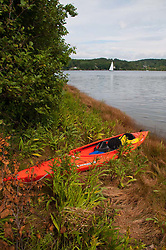 Kayak with Sailboat in the Distance, Upper Negro Island, Maine, US