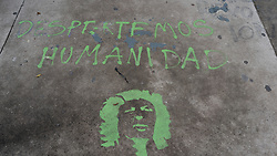 Despertemos humanidad - Wake up humanity - and a picture of Berta Caceres is painted on a pavement in Tegucigalpa