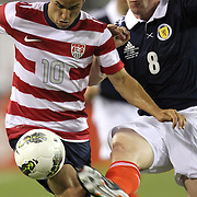 United States Forward Landon Donovan (10), Charlie Mulgrew (3) and Scott Brown (8), during an international friendly soccer match between Scotland and the United States at EverBank Field on Saturday, May 26, 2012 in Jacksonville, Florida.  The United States won the match 5-1 in front of 44,000 fans. (AP Photo/Alex Menendez)