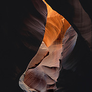Basically just a crack in the Earth that allows sunlight in, slot canyons are unique palces found in the Southwest.  This scene is on the Navajo Reservation, Arizona.