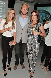 Left to right, DAISY DICKSON, OWAIN WALBYOFF and NATALIE PINKHAM at the Audemars Piguet Royal Oak Offshore 42mm Party held at Victoria House, Bloomsbury Square, London on 23rd April 2014.