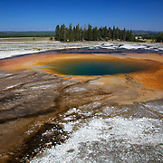 The colorful Opal Pool in Midway Geyser Basin, Yellowstone National Park, Wyoming.