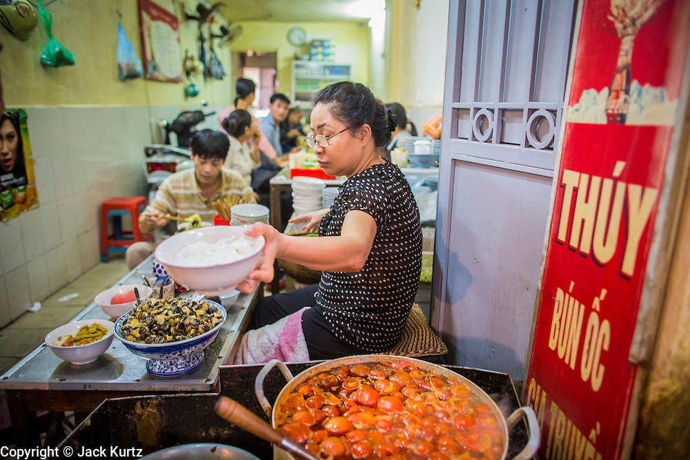 05 APRIL 2012 - HANOI, VIETNAM:   Women work in a noodle shop and restaurant in a market in Hanoi, the capital of Vietnam.   PHOTO BY JACK KURTZ