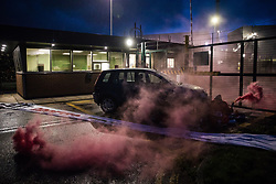 Sandwich, UK. 4th October, 2021. Two Palestine Action activists with smoke grenades are pictured locked onto a car to block an entrance to the Instro Precision factory in Discovery Park. Instro Precision is a subsidiary of Elbit Systems, Israel's largest publicly-traded arms company which markets drones used extensively by the Israeli military in Gaza as 'battle-proven', and it supplies 'high precision military equipment'. Palestine Action contends that equipment sold by Instro Precision has been used by the Israeli military against the civilian population of Gaza.