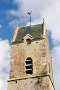 Cockerel, weathervane and louvre window on the tower of the church in Houesville, Normandy, France