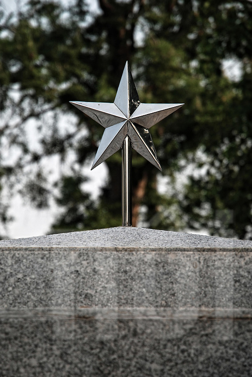 Star on the top of a grave in vietnamese cemetery of Vientiane, Laos, Asia.