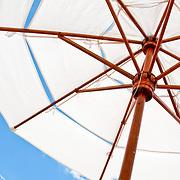 Canvas beach umbrellas providing shade by the pool at La Casa Que Canta, Zihuatanejo, Mexico