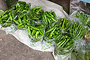 Green chillies for sale along the roadside in rural Bhutan. Chillies are the main ingredient in the Bhutanese national dish 'ema datse', chillies with cheese.
