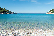 Crystal clear waters at Fillatro beach. Ithaca, Greece. The Greek island is situated in the Ionian Sea off the northeast coast of Kefalonia. Since antiquity, Ithaca has been identified as the home of the mythological hero Odysseus.