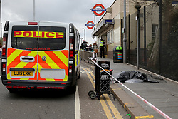 © Licensed to London News Pictures. 13/03/2019. London, UK. Crime scene outside Leyton Underground tube station in East London where a 17 year old boy was stabbed multiple times at 12.45pm. According to the Met Police, the victim is in a life threatening condition.  Photo credit: Dinendra Haria/LNP