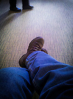 a day at the clinic showing feet while waiting for an appointment